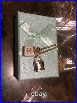 18 karat real gold black and white padlock pendant